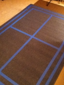 Step 1: Outline the border and mark the center of the rug with painter's tape.